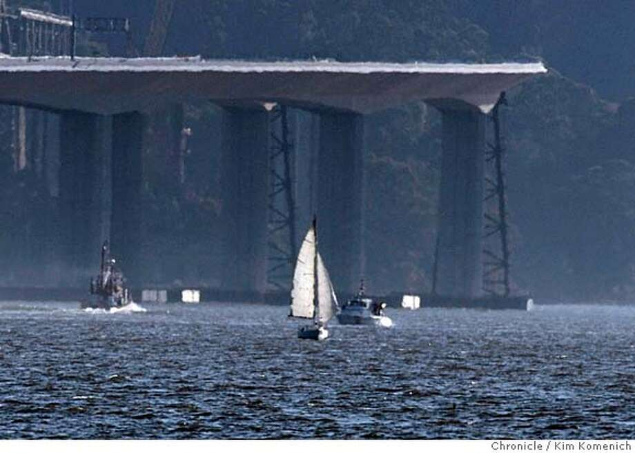 A fireboat departs and a Coast Guard vessel floats with a passing sailboat at the scene of a shipboard fire in San Francisco Bay near the eastern anchorage of the Bay Bridge on Saturday, April 12, 2008. Photo by Kim Komenich / San Francisco Chronicle Photo: Kim Komenich