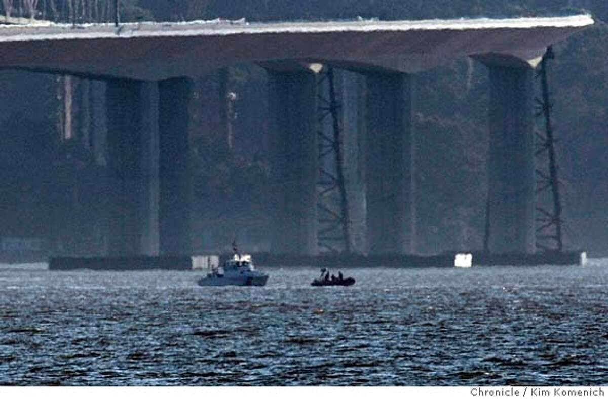A Coast Guard vessel floats with another boat near the scene of a shipboard fire in San Francisco Bay near the eastern anchorage of the Bay Bridge on Saturday, April 12, 2008. Photo by Kim Komenich / San Francisco Chronicle