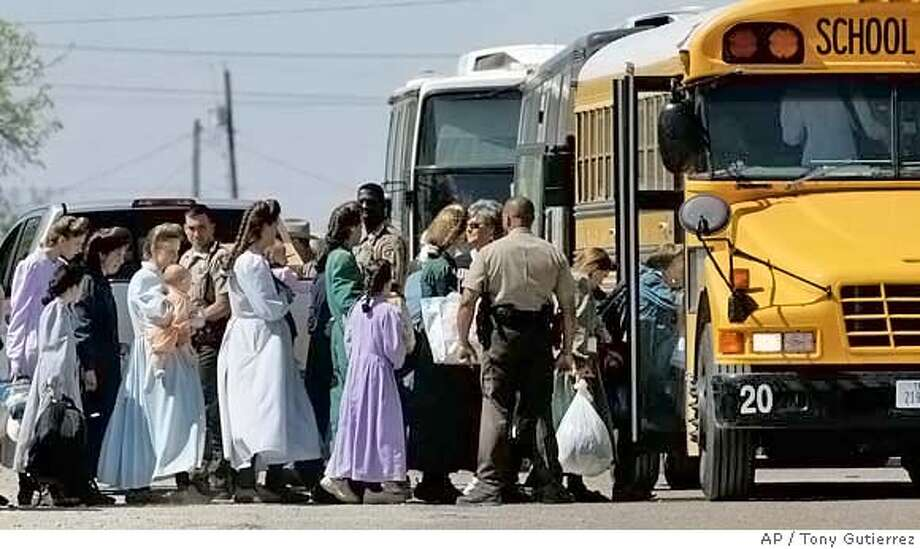 ###Live Caption:Law enforcement officials assist members of the Fundamentalist Church of Jesus Christ of Later Day Saints onto a school bus in Eldorado, Texas, Sunday, April 6, 2008. The group was relocated to San Angelo, Texas. Meanwhile, law enforcement agents continued their search of the compound built by followers of jailed polygamist leader Warren Jeffs. (AP Photo/Tony Gutierrez)###Caption History:Law enforcement officials assist members of the Fundamentalist Church of Jesus Christ of Later Day Saints onto a school bus in Eldorado, Texas, Sunday, April 6, 2008. The group was relocated to San Angelo, Texas. Meanwhile, law enforcement agents continued their search of the compound built by followers of jailed polygamist leader Warren Jeffs. (AP Photo/Tony Gutierrez)###Notes:###Special Instructions: Photo: Tony Gutierrez