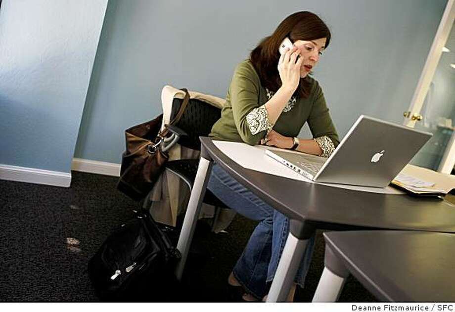 Heather McLeod Grant talks on the phone and works on her laptop at Cubes & Crayons in Menlo Park, Calif. on April 1, 2008.Photo by Deanne Fitzmaurice / San Francisco Chronicle Photo: Deanne Fitzmaurice, SFC