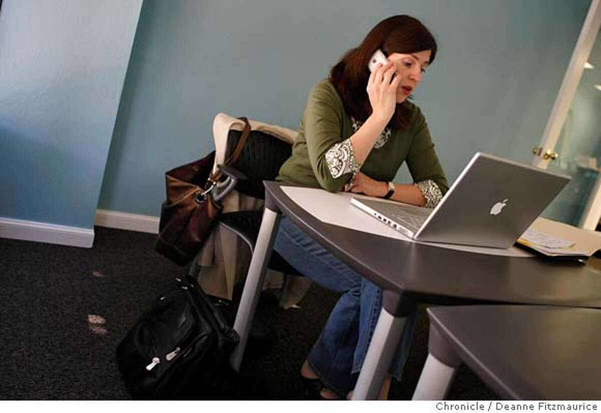 ###Live Caption:Heather McLeod Grant talks on the phone and works on her laptop at Cubes & Crayons in Menlo Park, Calif. on April 1, 2008. Photo by Deanne Fitzmaurice / San Francisco Chronicle###Caption History:Heather McLeod Grant talks on the phone and works on her laptop at Cubes & Crayons in Menlo Park, Calif. on April 1, 2008. Photo by Deanne Fitzmaurice / San Francisco Chronicle###Notes:###Special Instructions:Mandatory credit for photographer and San Francisco Chronicle. No Sales/Magazines out.
