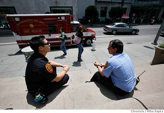 ###Live Caption:San Francisco paramedics, Mike Vela and Matt Fluke wait at their typical day-time post in front of Macy's in Union Square on Wednesday, May, 25, 2007in San Francisco, Calif. San Francisco's dynamically deployed ambulances are no longer stationed at the fire house. Instead they are post at strategic location though out the city in the interest of a quicker response time.  Photo by Mike Kepka / San Francisco Chronicle###Caption History:San Francisco paramedics, Mike Vela and Matt Fluke wait at their typical day-time post in front of Macy's in Union Square on Wednesday, May, 25, 2007in San Francisco, Calif. San Francisco's dynamically deployed ambulances are no longer stationed at the fire house. Instead they are post at strategic location though out the city in the interest of a quicker response time.  Photo by Mike Kepka / San Francisco Chronicle###Notes:(cq)###Special Instructions:MANDATORY CREDIT FOR PHOTOG AND SAN FRANCISCO CHRONICLE/NO SALES-MAGS OUT Photo: Mike Kepka