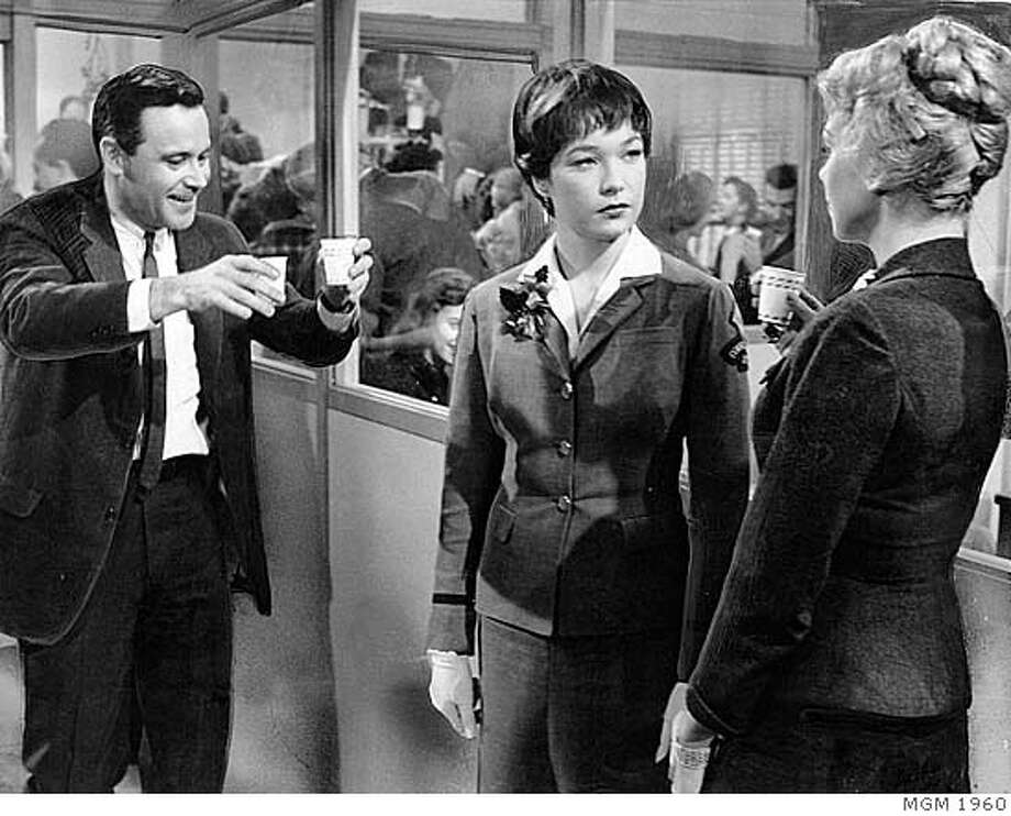 "###Live Caption:Jack Lemmon, Shirley MacLaine and Edie Adams in THE APARTMENT###Caption History:(L-R) Jack Lemmon, Shirley MacLaine and Edie Adams in the holiday office party scene from the movie ""The Apartment"" (1960, directed by Billy Wilder)  HANDOUT Ran on: 12-19-2004  Jack Lemmon, Shirley MacLaine and Edie Adams in &quo;The Apartment,'' a 1960 film by Billy Wilder, which has some of the most renowned scenes of the typical antics of the holiday office party.###Notes:###Special Instructions: Photo: Ho"