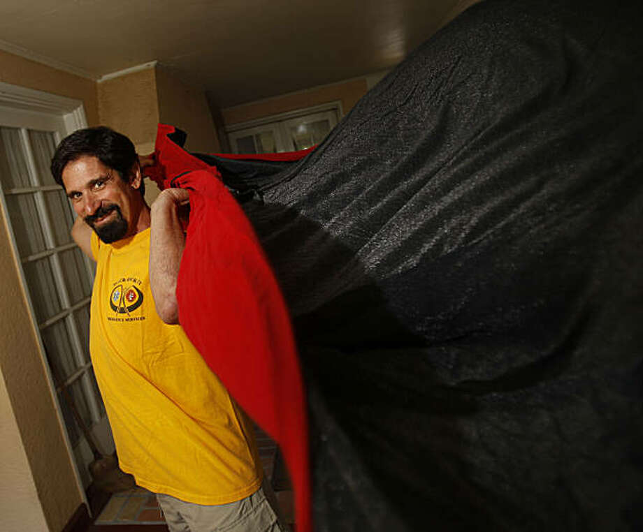 Marc Nelson is an ER doctor for Kasier Oakland and also for the past 10-years one of the medical chiefs at Burning Man festival in Nevada.  Marc tries out his Burning Man costume (vampire) at his home in Redwood City, Calif., on August 20, 2009. Photo: Frederic Larson, The Chronicle