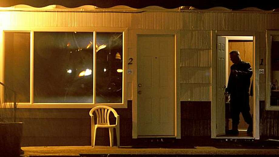 A man stands in the doorway of his room at the Thunderbird Motel next door to where fugitive Ryan Jenkins was found dead, in room number two, in Hope, British Columbia,  Sunday Aug. 23, 2009. RCMP say fugitive murder suspect Ryan Jenkins was found dead of an apparent suicide in a motel in the town of Hope about 90 minutes east of Vancouver.(AP Photo/THE CANADIAN PRESS/Darryl Dyck) Photo: Darryl Dyck, AP