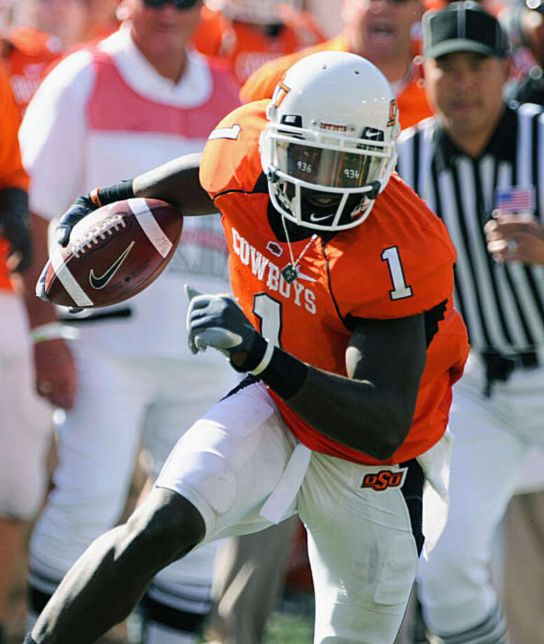 FILE --  In this Nov. 1, 2008 file photo, Oklahoma State wide receiver, Dez Bryant (1), runs the football during an NCAA college football game against Iowa in Stillwater. The combination of arguably the nation's top receiver, Dez Bryant, with playmakers Zac Robinson at quarterback and Kendall Hunter at tailback gives No. 9 Oklahoma State one of the most potent offenses in the country _ and for the first time in school history, a top 10 preseason ranking.  (AP Photo/Brody Schmidt, File) Photo: Brody Schmidt, AP