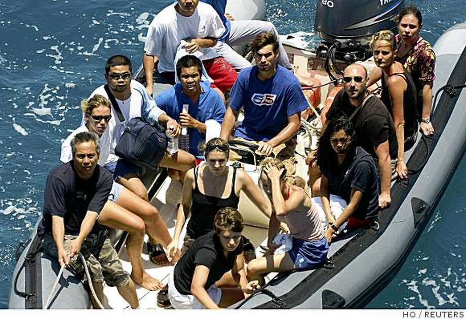 Crew members of the Ponant yacht make their way to boarding the Jean Bart navy frigate off Somalia's coast, Friday, April 11, 2008 in this photo provided by the French Defense Ministry. French commandos seized six pirates in Somalia on Friday during a daring helicopter raid launched shortly after the bandits had released the 30-strong crew of the luxury yacht hijacked last week. REUTERS/ECPAD/Sergent Dupont Sebastien  (SOMAILIA).  FOR EDITORIAL USE ONLY. NOT FOR SALE FOR MARKETING OR ADVERTISING CAMPAIGNS. Photo: HO, REUTERS