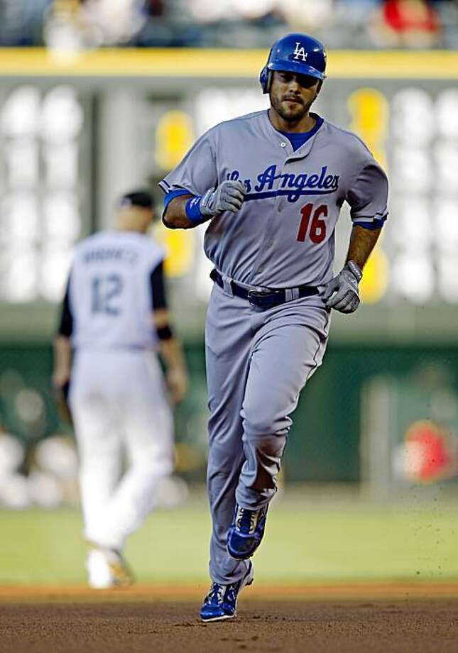 Los Angeles Dodgers' Andre Ethier rounds the bases after hitting a two-run home run off Colorado Rockies starting pitcher Josh Fogg during the first inning of a baseball game in Denver, Wednesday, Aug. 26, 2009.  (AP Photo/Jack Dempsey) Photo: Jack Dempsey, AP