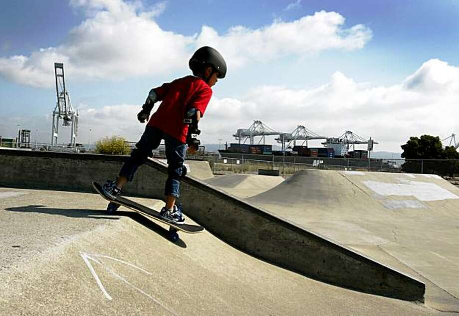 Michael Collins, 6, plays in a skateboard park at the Alameda Point community in Alameda, Calif., on Friday, Aug. 7, 2009. The park was built on the site after the former Naval Air Station was closed by the federal government. Photo: Paul Chinn, The Chronicle
