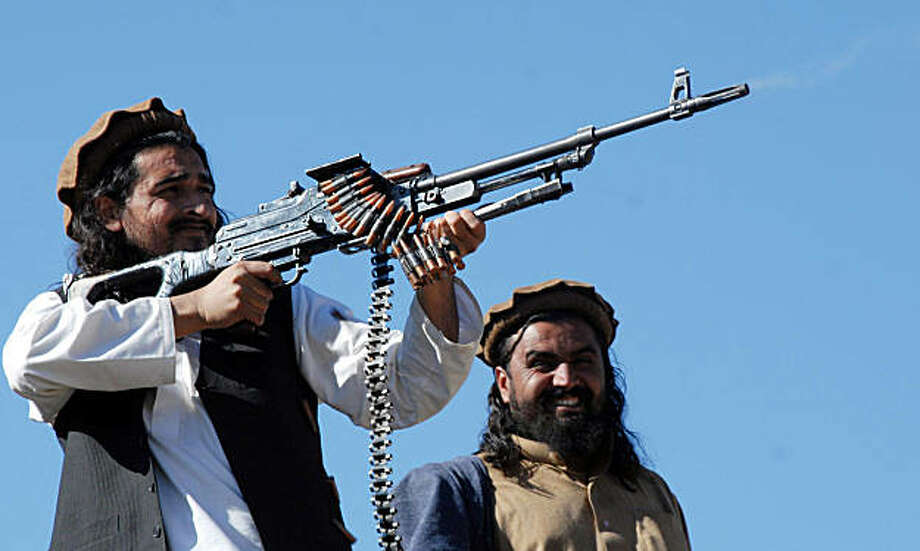 In this picture taken on November 26, 2008 Pakistani Taliban commander Hakimullah Mehsud poses and fires bullets for a group of media representatives in the Mamouzai area of Orakzai Agency. Pakistan's Taliban appears in turmoil after reports of a deadly shootout between contenders to replace the shadowy movement's leader, believed to have been killed in a US drone attack.   There are unconfirmed reports of a deadly shooting at a meeting of top Taliban commanders in South Waziristan region, which Interior Minister Rehman Malik said were being investigated. Hakimullah Mehsud is a deputy of Baitullah Mehsud and the warlord's main spokesman. Wali-ur Rehman is a senior commander in Baitullah Mehsud's umbrella Tehreek-e-Taliban Pakistan (TTP) movement. TOPSHOTS   AFP PHOTO/A MAJEED (Photo credit should read A Majeed/AFP/Getty Images) Photo: A Majeed, AFP/Getty Images
