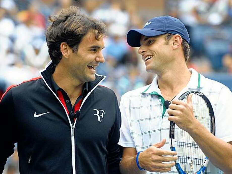 Roger Federer, left, and Andy Roddick laugh during the Arthur Ashe Kids Day in New York on Saturday, Aug. 29, 2009. (AP Photo/Peter Kramer) Photo: Peter Kramer, AP