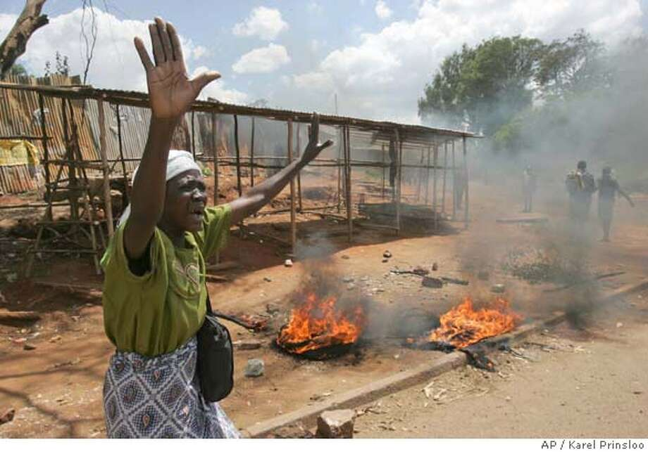 ###Live Caption:A woman appeals to the police to stop shooting tear gas, Tuesday, April 8, 2008 during clashes between police and opposition party supporters in the Kibera slum in Nairobi. Kenya's opposition party has suspended talks with the government on sharing power until President Mwai Kibaki dissolves his current Cabinet and agrees to negotiate a new government on a 50-50 basis, an opposition official said Tuesday.(AP Photo/Karel Prinsloo)###Caption History:A woman appeals to the police to stop shooting tear gas, Tuesday, April 8, 2008 during clashes between police and opposition party supporters in the Kibera slum in Nairobi. Kenya's opposition party has suspended talks with the government on sharing power until President Mwai Kibaki dissolves his current Cabinet and agrees to negotiate a new government on a 50-50 basis, an opposition official said Tuesday.(AP Photo/Karel Prinsloo)###Notes:###Special Instructions: Photo: KAREL PRINSLOO