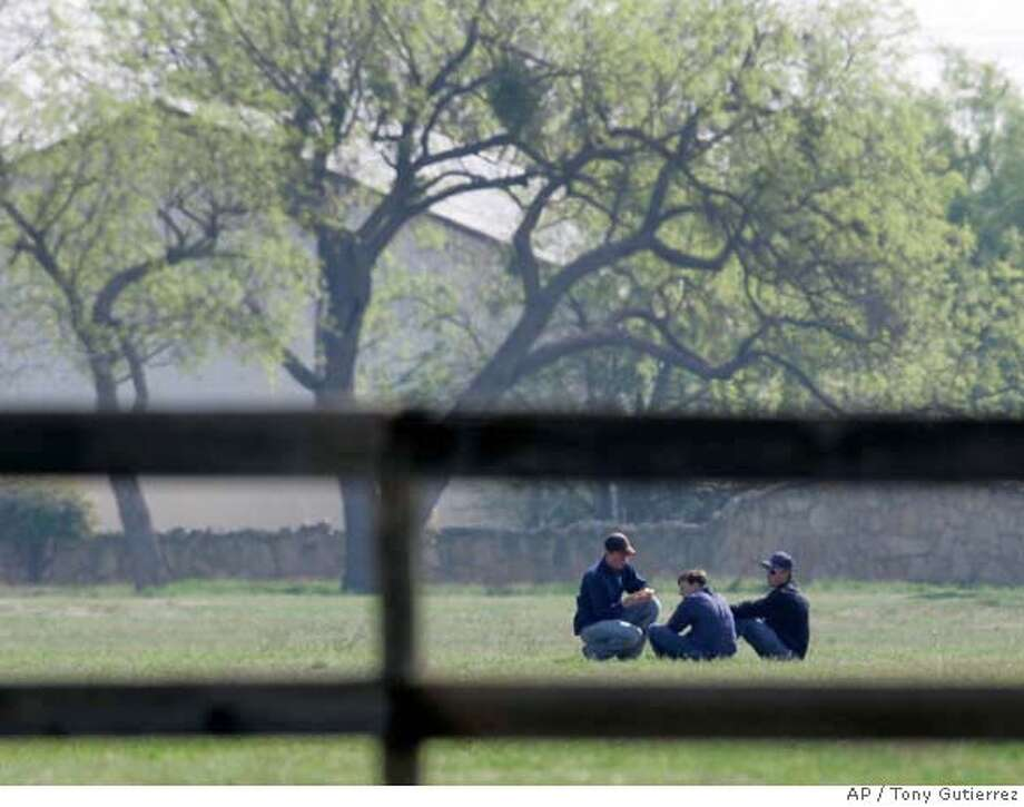 ###Live Caption:Young members of the Fundamentalist Church of Jesus Christ of Latter Day Saints are seen through a wooden fence as they sit in an open field after kicking a ball around at their temporary housing, Fort Concho National Historic Landmark, in San Angelo, Texas, Tuesday, April 8, 2008. (AP Photo/Tony Gutierrez)###Caption History:Young members of the Fundamentalist Church of Jesus Christ of Latter Day Saints are seen through a wooden fence as they sit in an open field after kicking a ball around at their temporary housing, Fort Concho National Historic Landmark, in San Angelo, Texas, Tuesday, April 8, 2008. (AP Photo/Tony Gutierrez)###Notes:###Special Instructions: Photo: Tony Gutierrez