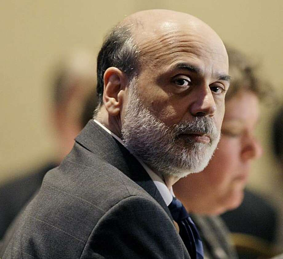FILE - In this April 17, 2009 file photo, Federal Reserve Board Chairman Ben Bernanke takes part in the Federal Reserve Sixth Biennial Community Affairs Research Conference in Washington. Federal Reserve Chairman Ben Bernanke, widely credited with taking aggressive action to avert an economic catastrophe after the financial meltdown last fall, will be nominated by President Barack Obama for a second term, The Associated Press learned Monday night Aug. 24, 2009. (AP Photo/Alex Brandon, File) Photo: Alex Brandon, AP