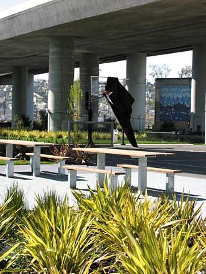 ###Live Caption:Black wrapping flutters from a basketball court at a new park across from 420 Berry St. in San Francisco that some residents want open now.###Caption History:Black wrapping flutters from a basketball court at a new park across from 420 Berry St. in San Francisco that some residents want open now.###Notes:###Special Instructions: Photo: John Cote