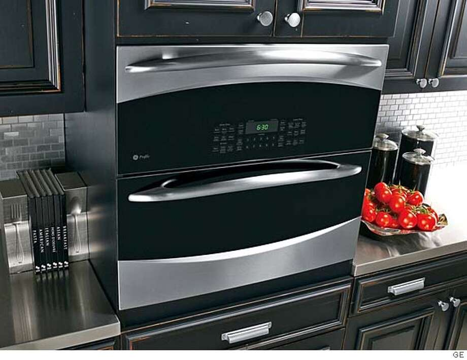 ###Live Caption:GE Profile Single/Double wall oven -- two ovens in one -- can cook two dishes at two separate temperatures at the same time; 30-inch single wall-oven space; 2.8 cubic foot lower oven; 2.2 cu. foot upper oven; est. retail $2799; available in October 2008###Caption History:GE Profile Single/Double wall oven -- two ovens in one -- can cook two dishes at two separate temperatures at the same time; 30-inch single wall-oven space; 2.8 cubic foot lower oven; 2.2 cu. foot upper oven; est. retail $2799; available in October 2008###Notes:###Special Instructions: Photo: GE