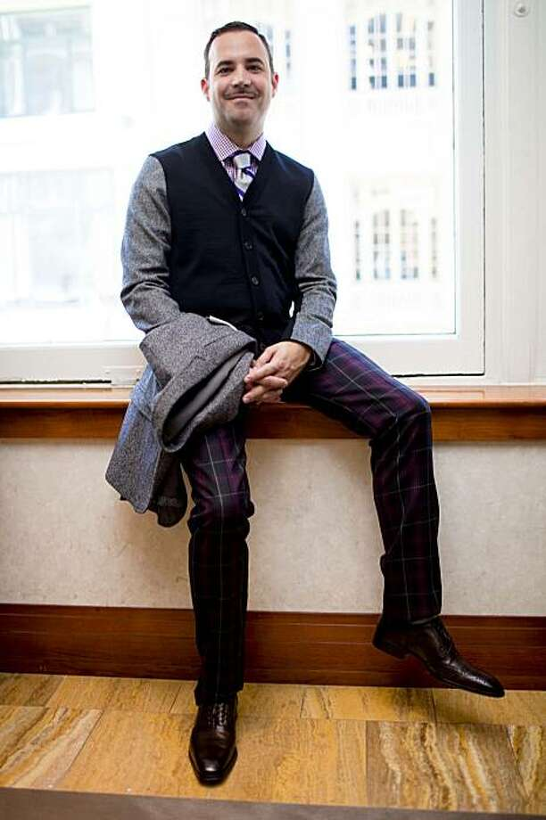 Saks Fifth Avenue fashion director Robert Arnold-Kraft poses with Saks' fall men's collection featuring, from top, Purple Gingham Shirt by Saks Fifth Avenue, Silk Gingham/Stripe Tie by Saks Fifth Avenue, Cashmere Zip Sweater by Saks Fifth Avenue, Neil Barrett MŽlange Jacket/Knit Cardigan with removable Shell, Gucci Wool Plaid Pant, and a Wing-Tip Brogue by To Boot New York at Saks' San Francisco location on Post St. in San Francisco, Calif. on Thursday, Aug. 13, 2009. Photo: Stephen Lam, The Chronicle