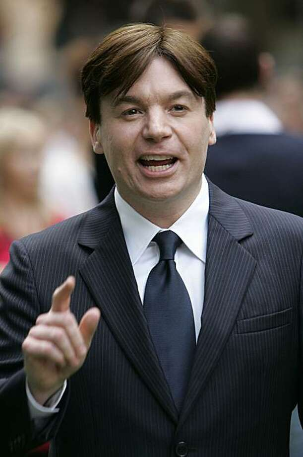 **FILE** Canadian actor Mike Myers, reacts to photographers at the London premier of their animated film ' Shrek the Third', in London in this June, 11, 2007 file photo. (AP Photo/Alastair Grant, file) Photo: Alastair Grant, AP