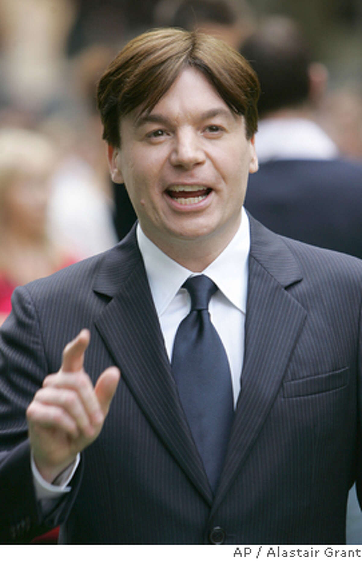 **FILE** Canadian actor Mike Myers, reacts to photographers at the London premier of their animated film ' Shrek the Third', in London in this June, 11, 2007 file photo. (AP Photo/Alastair Grant, file) Ran on: 04-10-2008 Mike Myers