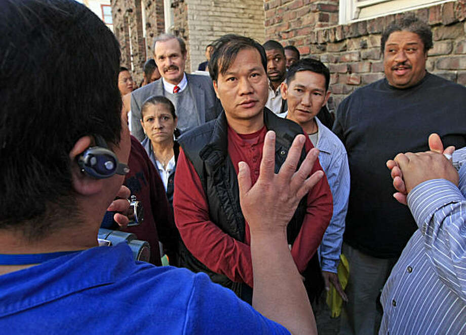 A person tries to keep order (left) as tempers fared while standing in line for for hours for a job fair at the edge of Chinatown in San Francisco, Calif., which drew thousands of people hoping to find a job out of the just 100 available June 19, 2009. Photo: Frederic Larson, The Chronicle