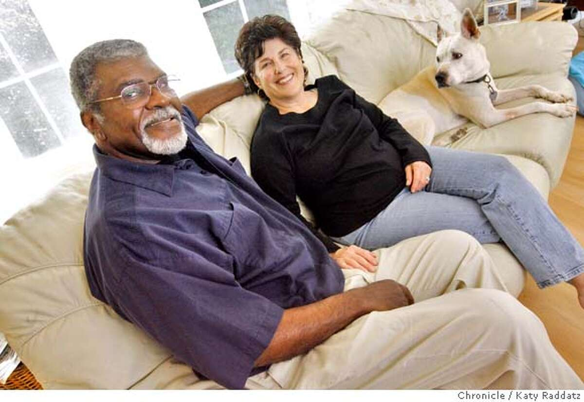 """Elbert """"Big Man"""" Howard and Carole Hyams are joined on their couch by their dog, """"Faith"""" in Forestville, Calif. on Sunday, March 9, 2008. Photo by Katy Raddatz / The San Francisco Chronicle"""