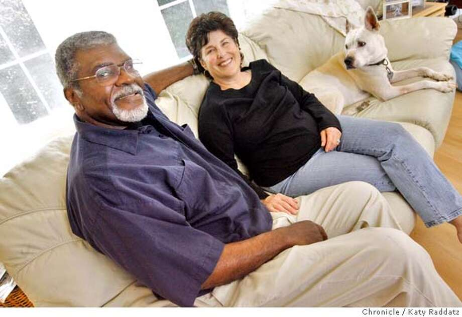 "Elbert ""Big Man"" Howard and Carole Hyams are joined on their couch by their dog, ""Faith"" in Forestville, Calif. on Sunday, March 9, 2008. Photo by Katy Raddatz / The San Francisco Chronicle Photo: KATY RADDATZ"