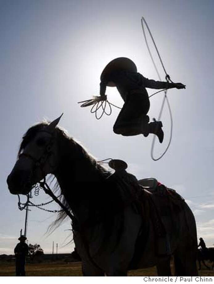 ###Live Caption:Tomas Garcilazo leaps through his lasso before the cattle drive for the 63rd annual Grand National Rodeo, Horse & Stock Show at the Cow Palace in Daly City, Calif., on Thursday, April 3, 2008. Garcilazo will be performing his rope tricks during the show running from April 4 thru April 12.  Photo by Paul Chinn / San Francisco Chronicle###Caption History:Tomas Garcilazo leaps through his lasso before the cattle drive for the 63rd annual Grand National Rodeo, Horse & Stock Show at the Cow Palace in Daly City, Calif., on Thursday, April 3, 2008. Garcilazo will be performing his rope tricks during the show running from April 4 thru April 12.  Photo by Paul Chinn / San Francisco Chronicle###Notes:Tomas Garcilazo###Special Instructions:MANDATORY CREDIT FOR PHOTOGRAPHER AND S.F. CHRONICLE/NO SALES - MAGS OUT Photo: Paul Chinn