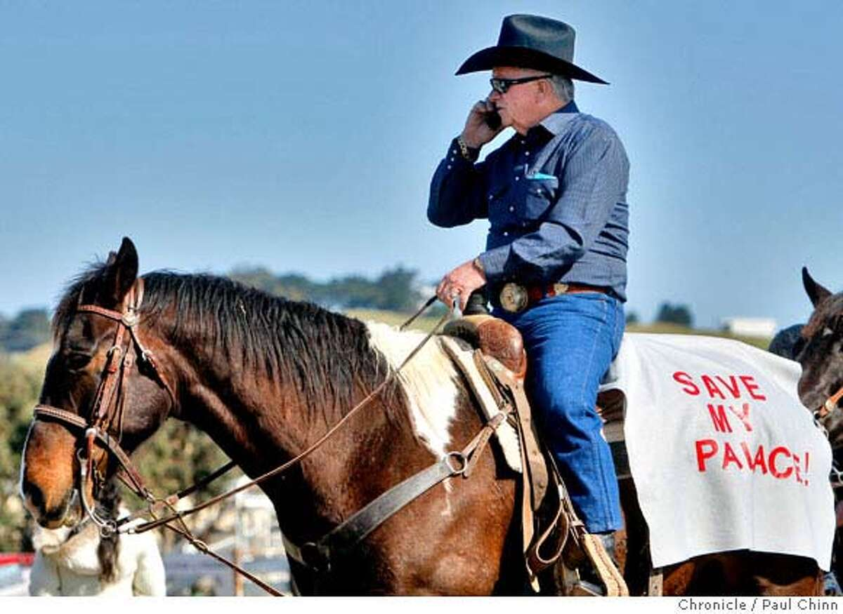FILE-- Leonard Stefanelli and others on horseback taking part in the cattle drive for the 63rd annual Grand National Rodeo, Horse & Stock Show had horse blankets with a message in Daly City, Calif., on Thursday, April 3, 2008. Stefanelli died April 6 after a long illness. He was 83.