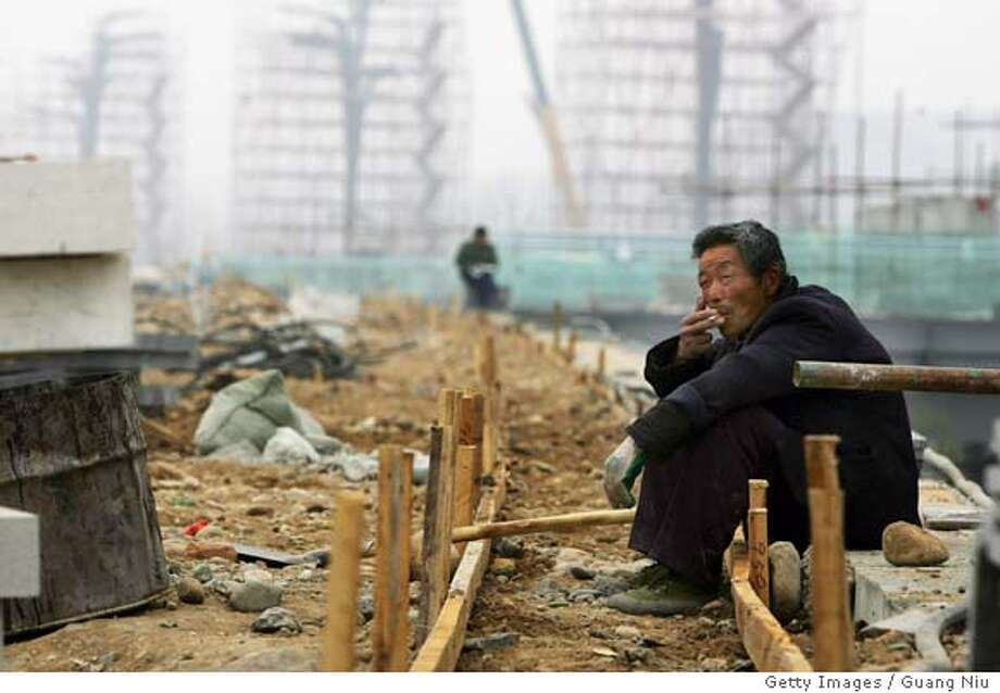 BEIJING - APRIL 08: A Chinese labourer takes a break from working at an Olympic venue construction site on April 8, 2008 in Beijing, China. The labourers come from all over the country and most of them could earn around RMB 2000 yuan ($286) per month. (Photo by Guang Niu/Getty Images)  Ran on: 04-09-2008  A Chinese laborer takes a break during construction of an Olympic venue in Beijing. Most workers earn about $286 a month.  Ran on: 04-09-2008  A Chinese laborer takes a break during construction of an Olympic venue in Beijing. Most workers earn about $286 a month.  Ran on: 04-09-2008 Photo: Guang Niu