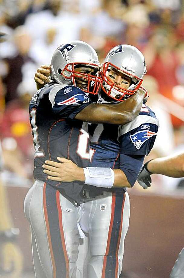 LANDOVER, MD - AUGUST 28:  Tom Brady #12 and Randy Moss #81 of the New England Patriots celebrate after scoring a touchdown in the second quarter of a preseason game against the Washington Redskins at FedExField on August 28, 2009 in Landover, Maryland.  (Photo by Greg Fiume/Getty Images) Photo: Greg Fiume, Getty Images