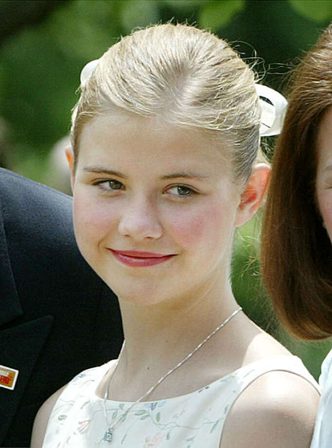 Elizabeth Smart, who was reunited with her family on March 12 after being kidnapped listens to President Bush speak before signing a wide-ranging package of child safety measures into law in the Rose Garden of the White House, in this April 30, 2003 file photo. Photo: Ron Edmonds, AP