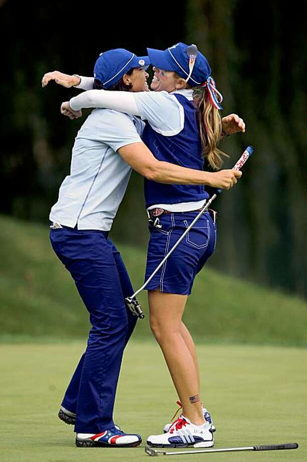 SUGAR GROVE, IL - AUGUST 21:  Juli Inkster of the USA rushes to celebrate with her partner Paula Creamer after Creamer had holed the winning putt on the 17th green during the Friday afternoon foursome matches at the 2009 Solheim Cup Matches, at the Rich Harvest Farms Golf Club on August 21, 2009 in Sugar Grove, Ilinois  (Photo by David Cannon/Getty Images) Photo: David Cannon, Getty Images