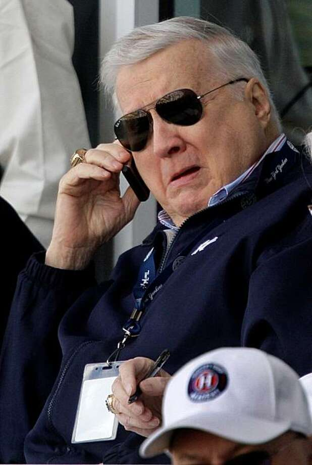 FILE - In this Feb. 26, 2009, file photo, New York Yankees principal owner George Steinbrenner talks on the phone in the owner's box during a spring training baseball game in Tampa, Fla. A former president of Madison Square Garden has sued  Steinbrenner, saying Steinbrenner reneged on a promise to make him a major part of the Yankees-operated television network after he suggested creating it more than a decade ago. (AP Photo/Gene J. Puskar,file) Photo: Gene J. Puskar, AP