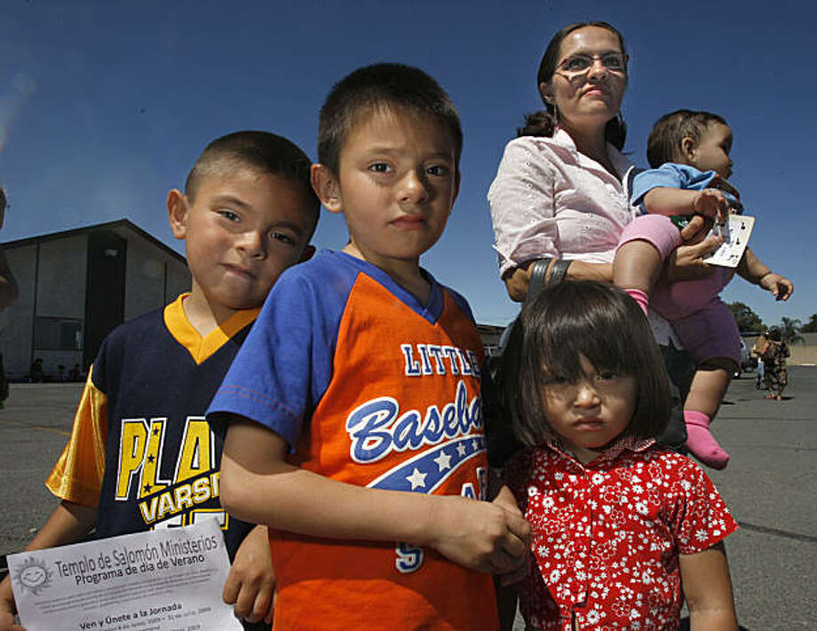 The Hernandez's family Josue Eliseo (5), Isaac (7), Rachal (3), Miriam Hernandez (mother) holding Marily (cq) came to get groceries at a Food giveaway program at Solomon Temple Missionary Baptist Church in Pittsburg, CAlif., on July 7, 2009. Photo: Frederic Larson, The Chronicle
