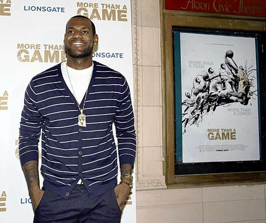"""Cleveland Cavaliers LeBron James appears on the red carpet at the advanced screening of the documentary """"More Than A Game"""" at the Akron Civic Center in Akron, Ohio on Thursday, Aug. 20, 2009.   The film documents the true life story of NBA star LeBron James and his Akron St. Vincent-St. Mary High School basketball teammates.  (AP Photo/Amy Sancetta) Photo: Amy Sancetta, AP"""