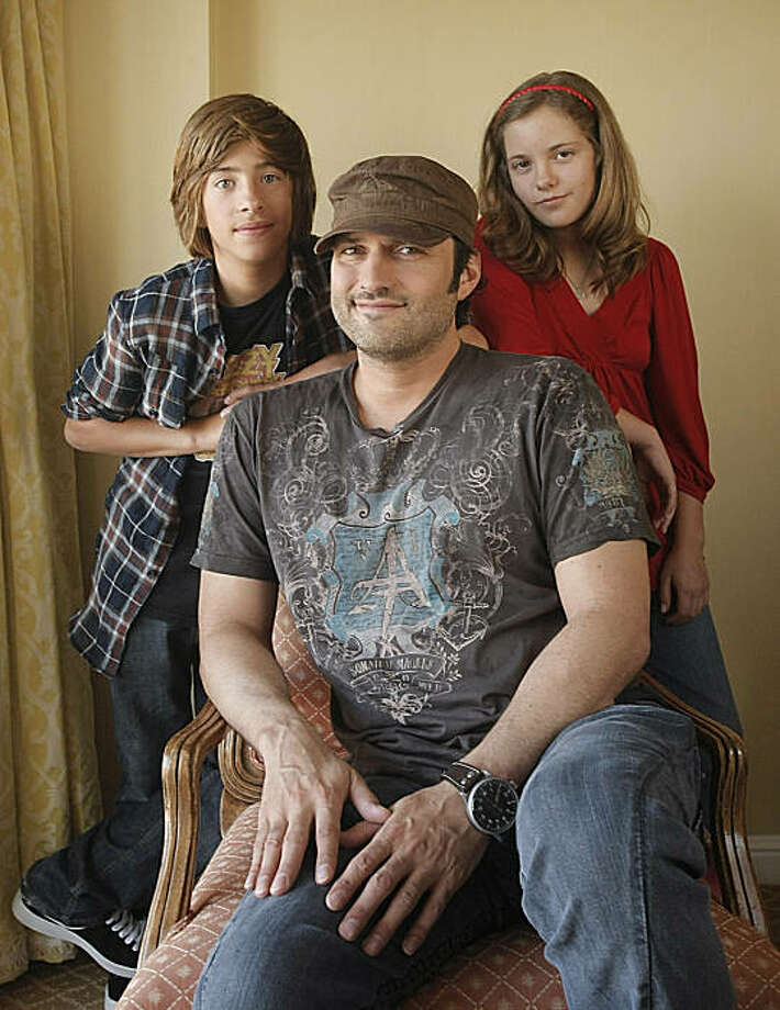 Director Robert Rodriguez, center, actor Jimmy Bennett, left, and actress Jolie Vanier pose for a portrait at the Four Seasons Hotel in Los Angeles on Sunday, Aug. 9, 2009. Photo: Dan Steinberg, AP