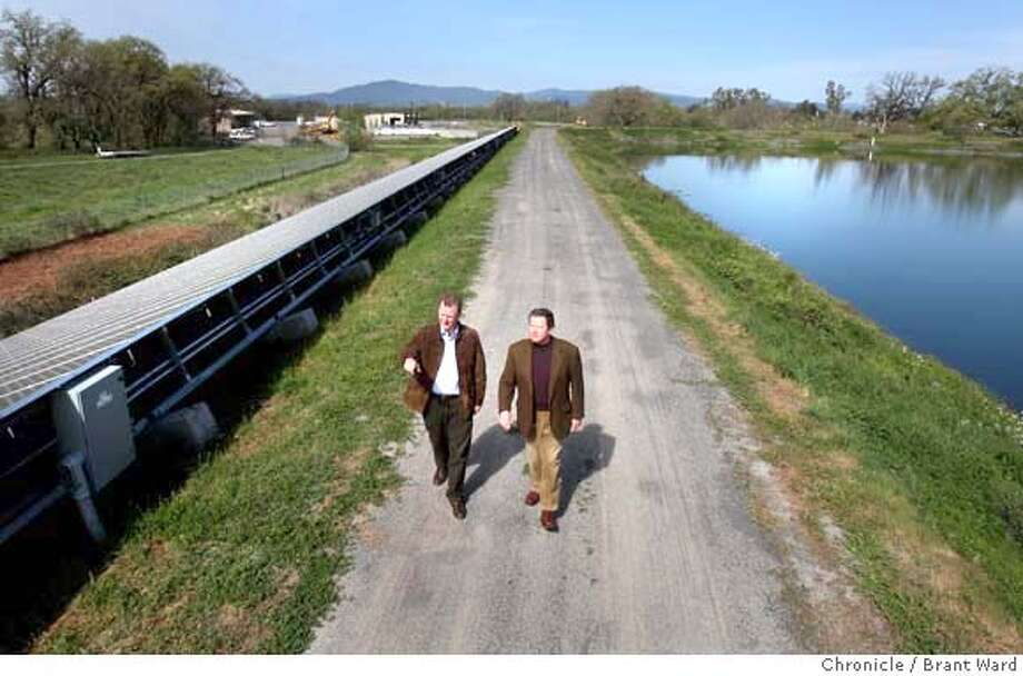 "###Live Caption:During a tour of a modern water treatment plant in Santa Rosa, Calif., on April 2, 2008, Supervisor Paul Kelley, left, and Clay Gregory of Kendall-Jackson winery passed solar panels and a holding pond. Sonoma County officials want to add ""treated wastewater"" to the ranks of alternative energy sources. Photo by Brant Ward / San Francisco Chronicle###Caption History:During a tour of a modern water treatment plant in Santa Rosa, Supervisor Paul Kelley, left, and Clay Gregory of Kendall-Jackson winery passed solar panels and a holding pond. Sonoma County officials want to add ""treated wastewater"" to the ranks of alternative energy sources. Photo by Brant Ward / San Francisco Chronicle###Notes:###Special Instructions: Photo: Brant Ward"