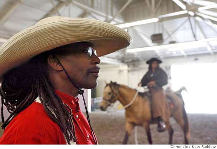 """###Live Caption:Miles Dean, left, a 52 year old social studies teacher from New Jersey, lets his friend Lynndell Johnson work out on his horse Sankofa, inside the warm up area in the Cow Palace before riding in the entrance parade to the Grand National Rodeo. Dean rode his horse Sankofa, which means """"to return to the source"""" in Ghana, all the way across the country to bring attention to black cowboys. He ends his journey at the Grand National Rodeo at the Cow Palace, in San Francisco, Calif. on Sunday, April 6, 2008.  Photo by Katy Raddatz / San Francisco Chronicle###Caption History:Miles Dean, left, a 52 year old social studies teacher from New Jersey, lets his friend Lynndell Johnson work out on his horse Sankofa, inside the warm up area in the Cow Palace before riding in the entrance parade to the Grand National Rodeo. Dean rode his horse Sankofa, which means """"to return to the source"""" in Ghana, all the way across the country to bring attention to black cowboys. He ends his journey at the Grand National Rodeo at the Cow Palace, in San Francisco, Calif. on Sunday, April 6, 2008.  Photo by Katy Raddatz / San Francisco Chronicle###Notes:Miles Dean, Lynndell Johnson, Sankofa###Special Instructions:MANDATORY CREDIT FOR PHOTOG AND SAN FRANCISCO CHRONICLE/NO SALES-MAGS OUT Photo: KATY RADDATZ"""
