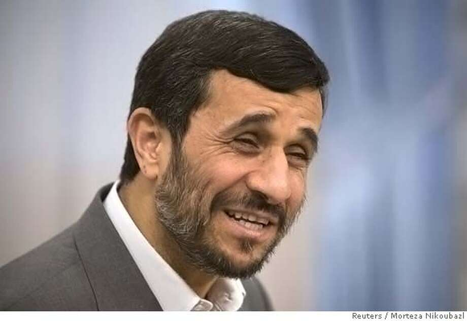###Live Caption:Iranian President Mahmoud Ahmadinejad smiles while speaking with photographers before an official meeting with OPEC Secretary General Abdullah el-Badri in Tehran April 6, 2008. REUTERS/Morteza Nikoubazl (IRAN)###Caption History:Iranian President Mahmoud Ahmadinejad smiles while speaking with photographers before an official meeting with OPEC Secretary General Abdullah el-Badri in Tehran April 6, 2008. REUTERS/Morteza Nikoubazl (IRAN)###Notes:Iranian President Ahmadinejad smiles before an official meeting with OPEC Secretary General el-Badri in Tehran###Special Instructions:0 Photo: MORTEZA NIKOUBAZL