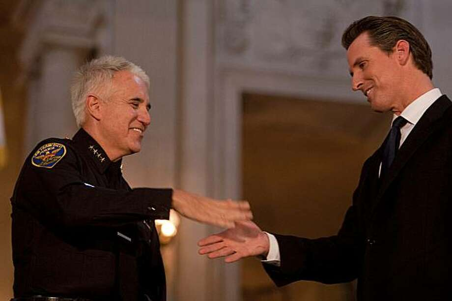 San Francisco Police Chief George Gascon, left, takes a oath of office with Mayor Gavin Newsom for the second time in a public ceremony held at the City Hall Rotunda in San Francisco, on Friday, Aug. 21, 2009. Photo: Stephen Lam, The Chronicle