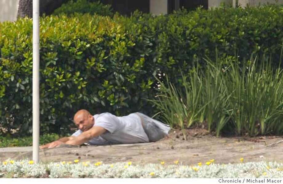 ###Live Caption:Suspect, James Henderson, crawls on his stomach towards police as he surrenders after 7 rounds of tear gas were shot into his residence. Henderson, who reportedly raped a woman and then barricaded himself inside, was in standoff with police at his home at the Villas Papillion townhouse complex, in Fremont, Ca. on April 1, 2008.  Photo by Michael Macor/ San Francisco Chronicle###Caption History:Suspect, James Henderson, crawls on his stomach towards police as he surrenders after 7 rounds of tear gas were shot into his residence. Henderson, who reportedly raped a woman and then barricaded himself inside, was in standoff with police at his home at the Villas Papillion townhouse complex, in Fremont, Ca. on April 1, 2008.  Photo by Michael Macor/ San Francisco Chronicle###Notes:###Special Instructions:Mandatory credit for Photographer and San Francisco Chronicle No sales/ Magazines Out Photo: Michael Macor