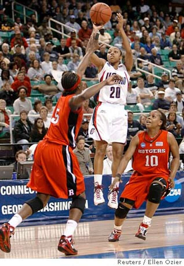 The University of Connecticut's Renee Montgomery (C) shoots against Rutgers University's Essence Carson (L) and Epiphanny Prince during the first half of their NCAA women's East Regional Championship basketball game in Greensboro April 1, 2008. REUTERS/Ellen Ozier (UNITED STATES)  Ran on: 04-02-2008  UConn's Renee Montgomery (20) takes her next shot against Stanford on Sunday.  Ran on: 04-02-2008 Photo: ELLEN OZIER