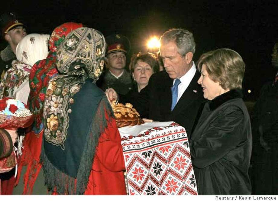 ###Live Caption:U.S. President George W. Bush is given the traditional greeting of karavai (bread) and salt as he and first lady Laura Bush arrive in Kiev, March 31, 2008. Bush will spend a day here before attending the NATO Summit in Bucharest. REUTERS/Kevin Lamarque (UKRAINE)###Caption History:U.S. President George W. Bush is given the traditional greeting of karavai (bread) and salt as he and first lady Laura Bush arrive in Kiev, March 31, 2008. Bush will spend a day here before attending the NATO Summit in Bucharest. REUTERS/Kevin Lamarque (UKRAINE)###Notes:President Bush arrives in Kiev###Special Instructions:0 Photo: KEVIN LAMARQUE