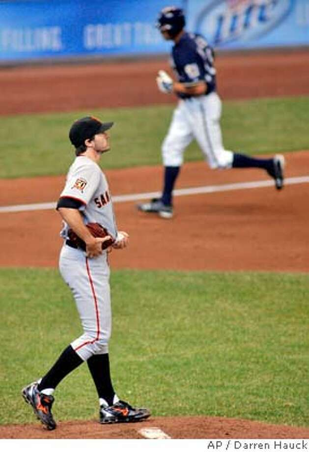 Milwaukee Brewers' Ryan Braun, right, rounds third base after hitting a home run against San Francisco Giants starting pitcher Barry Zito, left, in the fifth inning of the baseball game Sunday, April 6, 2008, in Milwaukee. (AP Photo/Darren Hauck) Photo: Darren Hauck