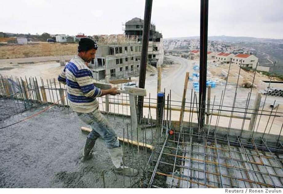 ###Live Caption:A labourer works atop a building under construction in the West Bank Jewish settlement of Givat Ze'ev March 31, 2008. U.S. Secretary of State Condoleezza Rice said on Monday Israel must stop expanding Jewish settlements but voiced confidence peace talks were on track despite an Israeli announcement of a new housing project. REUTERS/Ronen Zvulun (WEST BANK)###Caption History:A labourer works atop a building under construction in the West Bank Jewish settlement of Givat Ze'ev March 31, 2008. U.S. Secretary of State Condoleezza Rice said on Monday Israel must stop expanding Jewish settlements but voiced confidence peace talks were on track despite an Israeli announcement of a new housing project. REUTERS/Ronen Zvulun (WEST BANK)###Notes:Labourer works atop building under construction in settlement of Givat Ze'ev###Special Instructions:0 Photo: RONEN ZVULUN