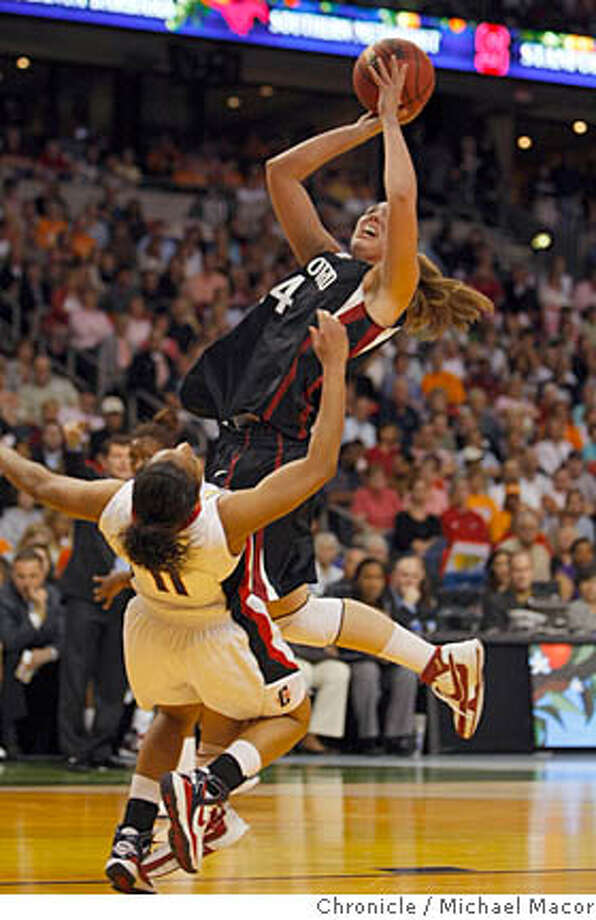 Stanford's Kayla Pedersen charges to the basket agianst Connecticut's Ketia Swanier for a first half basket in the NCAA semi finals in Tampa, Florida on April 6, 2008. Photo by Michael Macor/ San Francisco Chronicle Ran on: 04-07-2008  Kayla Pedersen , above, goes up over Ketia Swanier. At top, Jillian Harmon and Jayne Appel celebrate.  Ran on: 04-07-2008  Stanford's Kayla Pedersen, above, goes over Ketia Swanier. At top, Jillian Harmon and Jayne Appel celebrate. Photo: Michael Macor