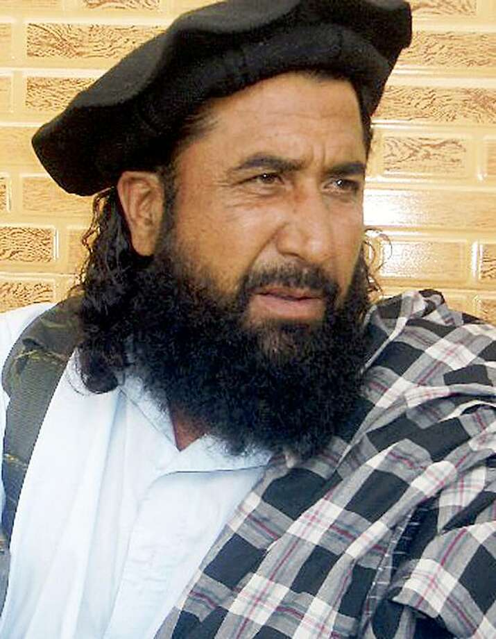 FILE-In this file photo taken on Aug. 5, 2008,  Pakistani Taliban's top spokesman Maulvi Umar is seen in Khar of Pakistani tribal region of Bajur. Security forces captured the Pakistani Taliban's top spokesman in an operation near the Afghan border, a government official said Tuesday, Aug. 18, 2009,  dealing another blow to the militants following the reported killing of their leader earlier this month. (AP Photo/Anwarullah Khan, File) Photo: Anwarullah Khan, AP