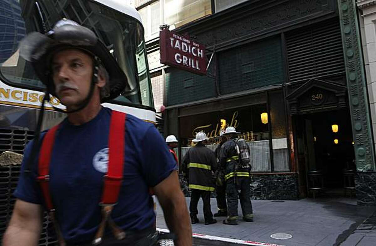 Fire fighters from the San Francisco Fire Department work on a two alarm fire at the historic Tadich Grill in Downtown San Francisco on Monday Aug. 24, 2009. The fire briefly interrupted cable car service on California Street.