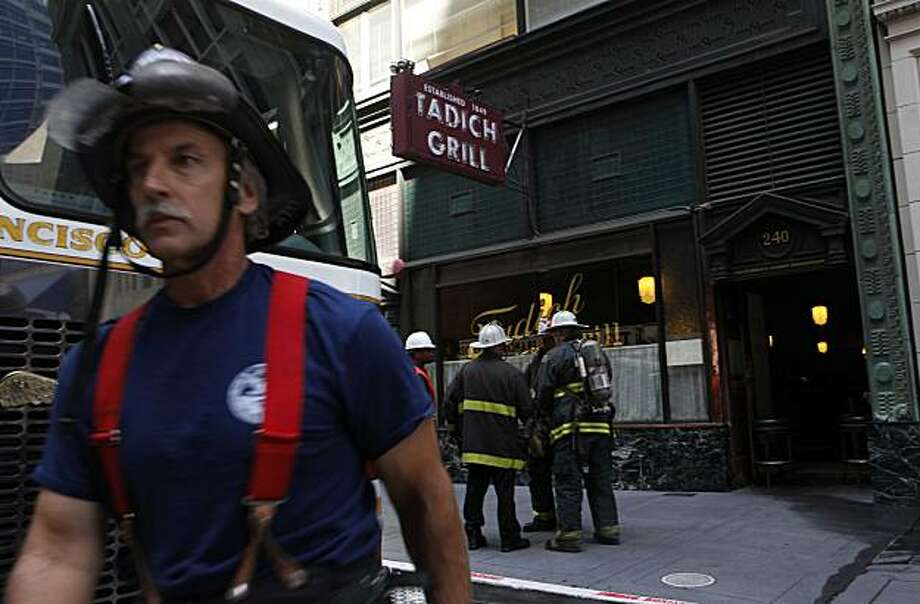 Fire fighters from the San Francisco Fire Department work on a two alarm fire at the historic Tadich Grill in Downtown San Francisco on Monday Aug. 24, 2009. The fire briefly interrupted cable car service on California Street. Photo: Mike Kepka, The Chronicle