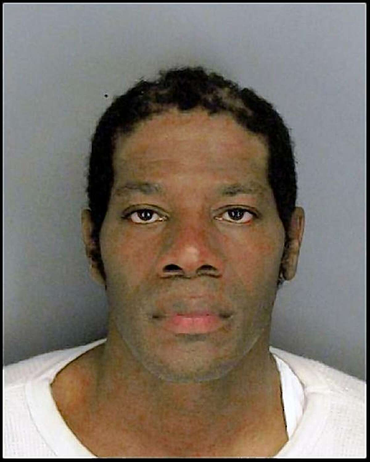 This Placer County Jail booking photo shows Nathaniel Burris on Wednesday, August 12, 2009. Burris, accused of killing his ex-girlfriend and her male friend at the Richmond-San Rafael Bridge toll plaza, insisted on pleading guilty during a brief court hearing in Martinez, Calif., on August 14, 2009.